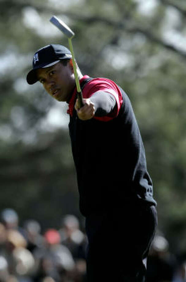 Tiger Woods watches his birdie putt roll in on the first hole. After making birdie on No. 1, Woods birded only one other hole on the front nine. Photo: Jeff Gross, Getty Images