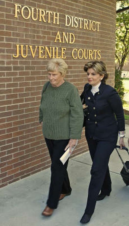 Famous attorney Gloria Allred, right, is representing Betty Perry in the dispute over Perry's lawn. Authorities say she refused to maintain her lawn and resisted arrest. Photo: GEORGE FREY, Associated Press
