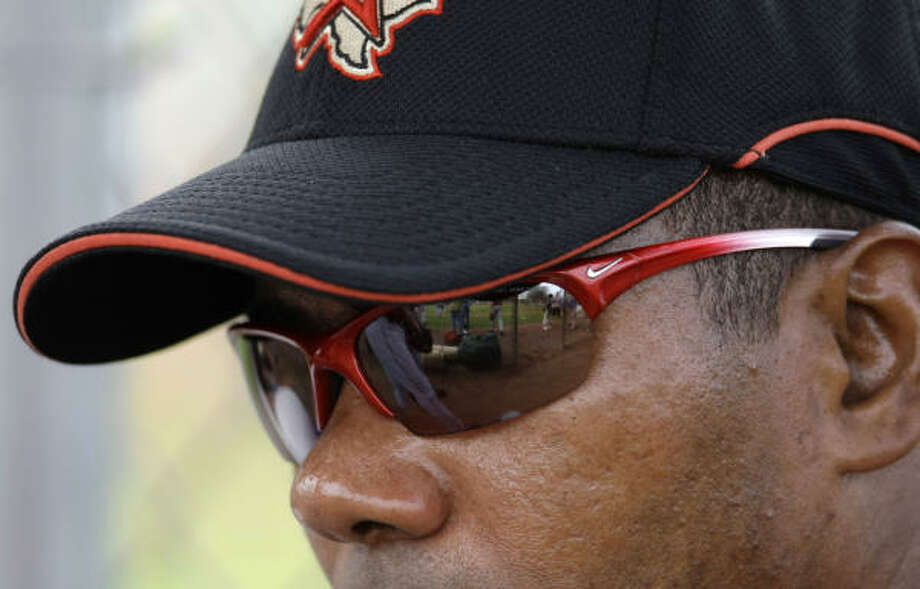 "Miguel Tejada monitors a workout. His advice from manager Cecil Cooper this spring has been to ""relax and play baseball."" Photo: Karen Warren, Houston Chronicle"