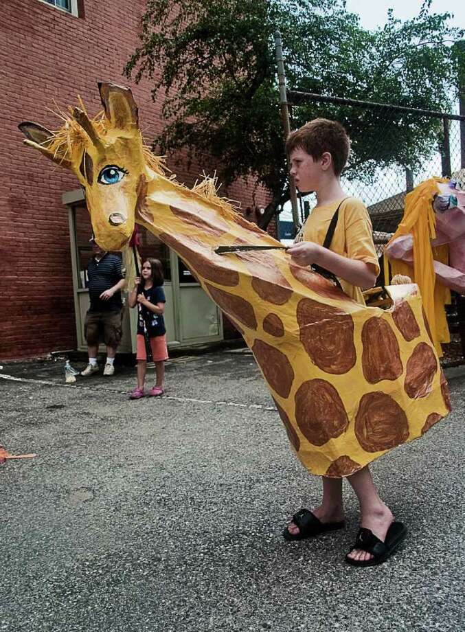 Norwalk's SoNo Arts Celebration on August 7 featured a puppet parade in which attendees were encouraged to pick up a puppet and join the performers. Photo: Mike Macklem / Hearst Connecticut Media Group