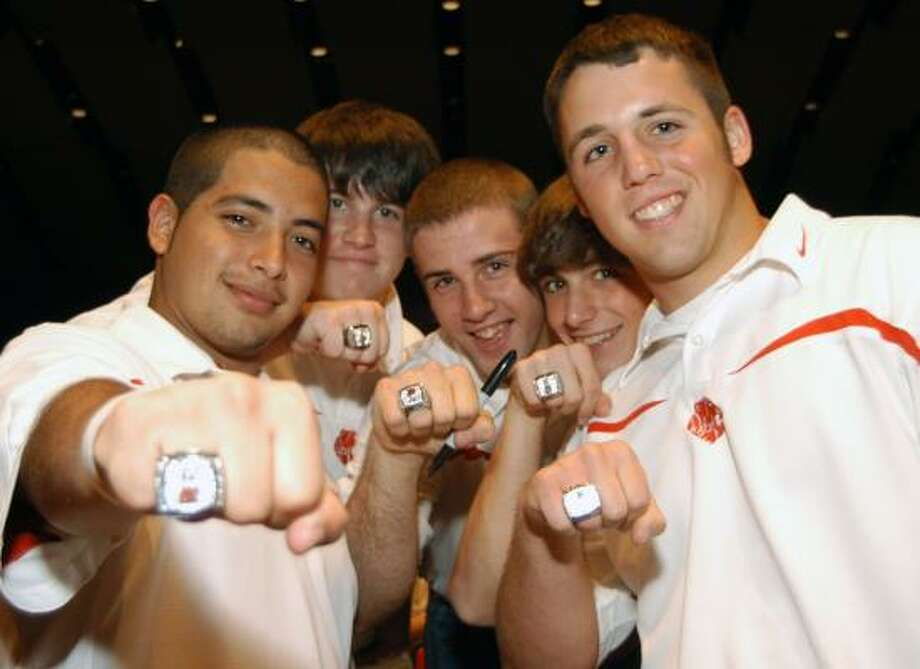 David Sanchez, left, Cody Cox, Tory Brown, Sam Highnote and Stephen Morton show off their championship rings during a celebration of the Katy High School football team winning the 2007 Texas 5A State Championship. Photo: Robert Barreda, For The Chronicle