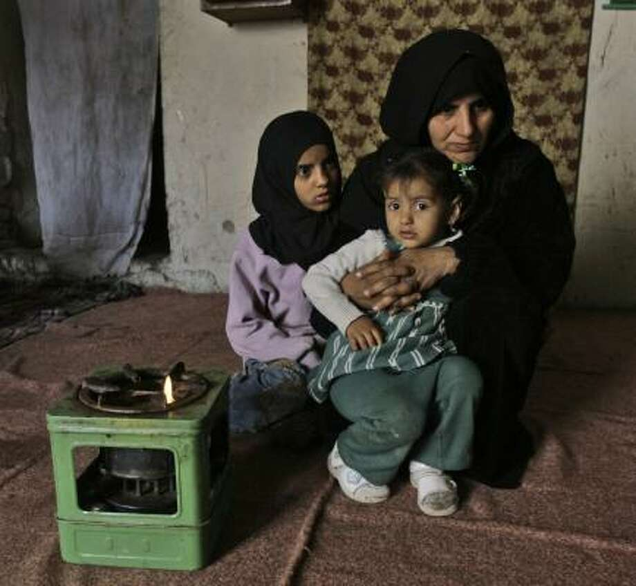 Badriyah Hamid, a 45-year-old Shiite cleaning woman, cares for two of her 10 children. After her husband was shot to death in 2007, she moved in with her in-laws but eventually got a two-room house with rent money donated by a neighbor. She has to scavenge for scraps of food at a nearby market. Photo: KARIM KADIM PHOTOS, ASSOCIATED PRESS