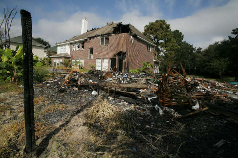 The house of Texas Supreme Court Justice David Medina, gutted by a fire. Photo: Steve Ueckert, Chronicle