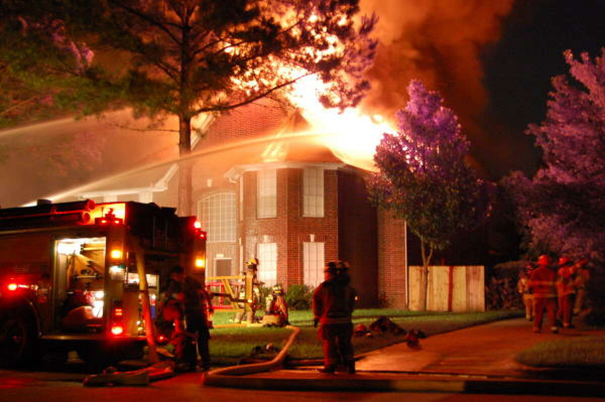 Three homes were damaged and four firefighters suffered minor injuries in the fire.