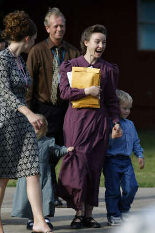 A mother from the Fundamentalist Church of Jesus Christ of Latter Day Saints leaves the Kidz Harbor facility in Liverpool with her children. Photo: Johnny Hanson, Chronicle