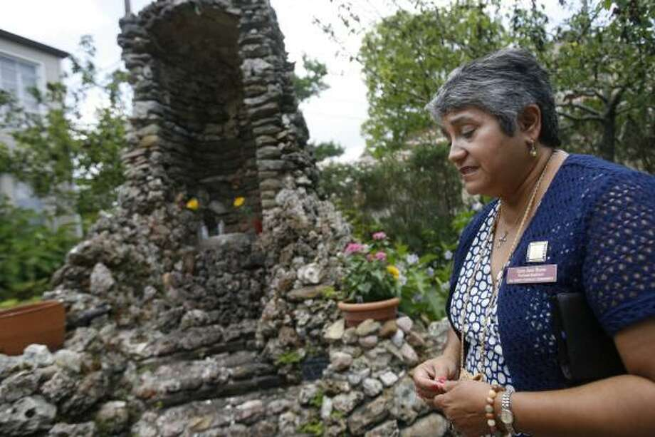 "Cary Ann Nunn, a parish pastoral assistant, said the attacks might be less disturbing if they were done by juvenile delinquents. But the possibility that the desecrations have been done for theological reasons ""really bothers everyone."" Photo: MAYRA BELTRÁN, CHRONICLE"