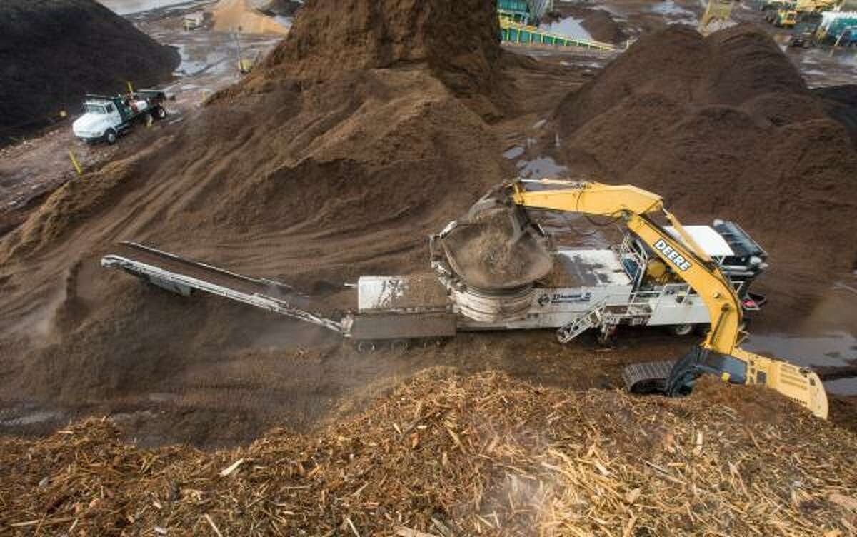 Some of the debris from trees damaged or felled by Hurricane Ike is being turned into mounds of mulch at Living Earth Technology in northwest Houston. But the sheer volume of debris far outstrips local market demand for mulch.