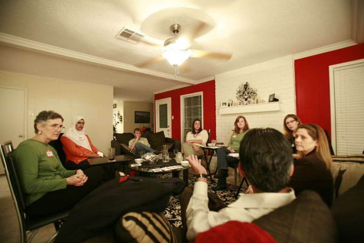 Participants discuss their religious views during the dialogue. The dinner was one of many in Houston and across the country.