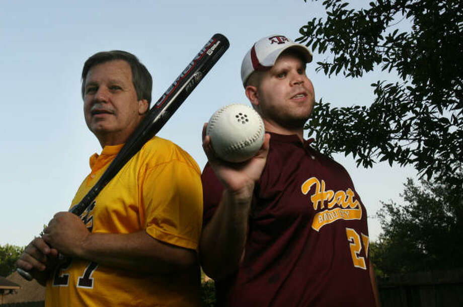 Charles Boudreaux, left, of Deer Park is delighted that his son Blake has found an athletic outlet in Beep Baseball. Photo: Mayra Beltran, For The Chronicle