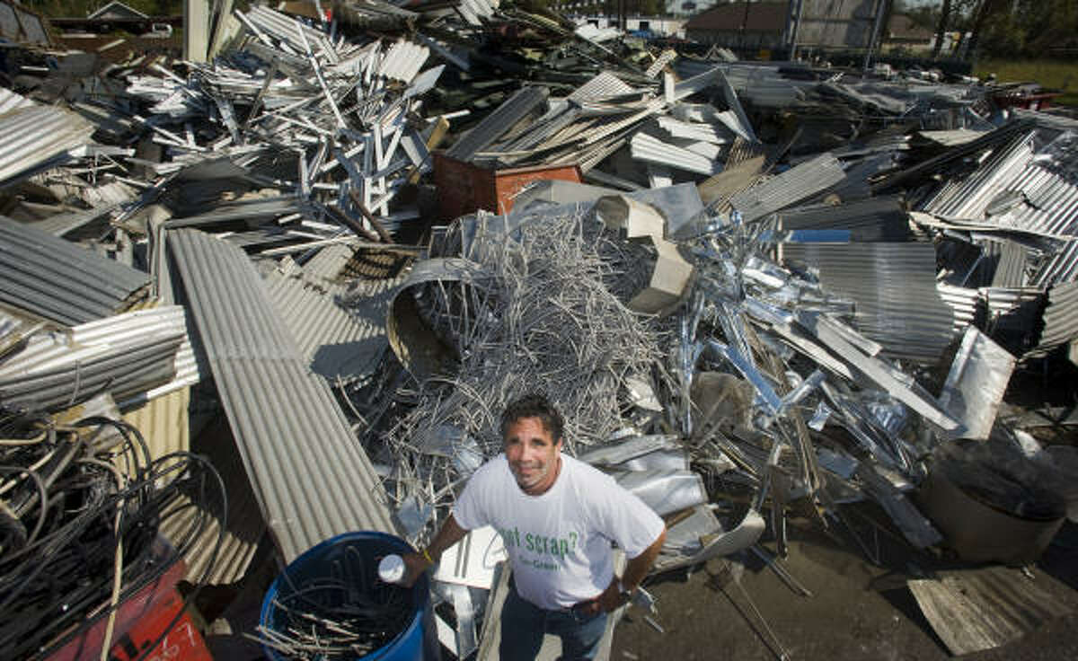 Owner Dennis Laviage ran his business, C & D Scrap Metal, despite being without electricity for two weeks following Hurricane Ike.
