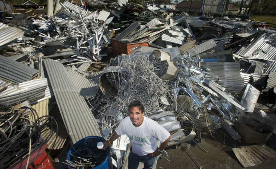 Owner Dennis Laviage ran his business, C & D Scrap Metal, despite being without electricity for two weeks following Hurricane Ike. Photo: Steve Ueckert, Chronicle