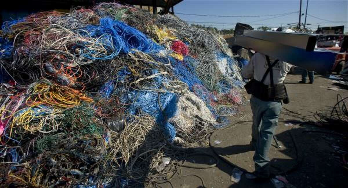 C&D Scrap Metal overflows with product, including a huge pile of copper wire.