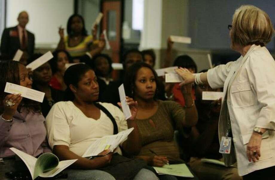 Joeletta Patrick, left, Teshana McDowell and Teesha Davis train with Marty Morrison, right, of Harris County's voter registration office, to become deputy voter registrars at the Houston Area Urban League. Photo: ERIC KAYNE, CHRONICLE