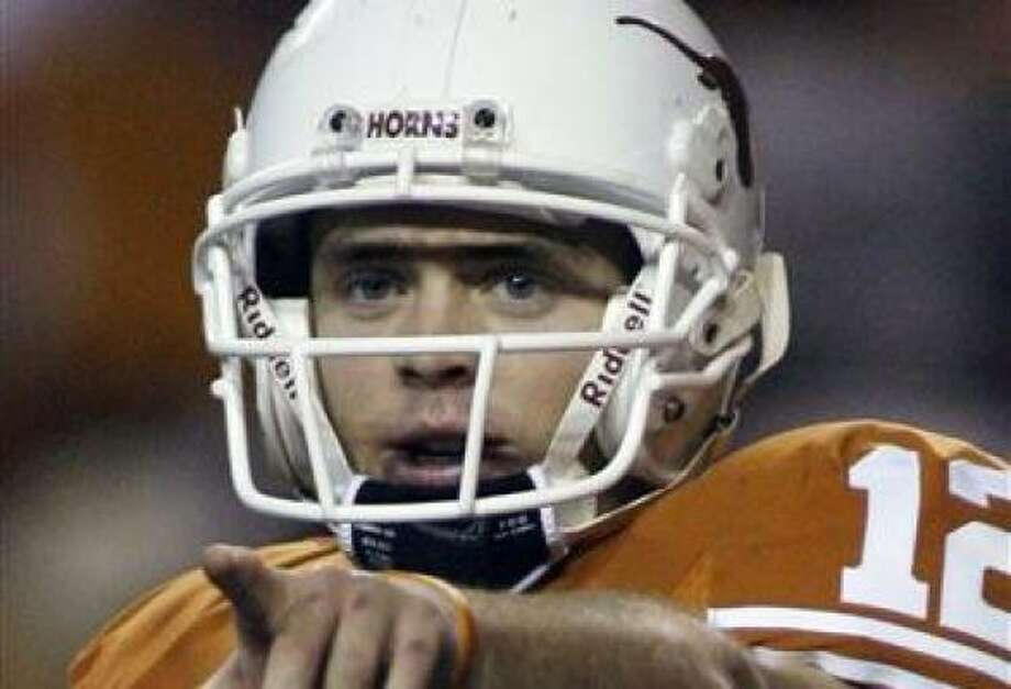 Texas quarterback Colt McCoy and the Longhorns beat Oklahoma earlier in the season. Photo: Harry Cabluck, AP