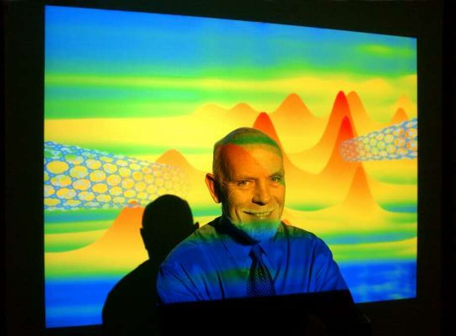 The late Rice University professor Richard Smalley is shown in this 2003 photo in front of a projection of nanotubes. Photo: SMILEY N. POOL, CHRONICLE