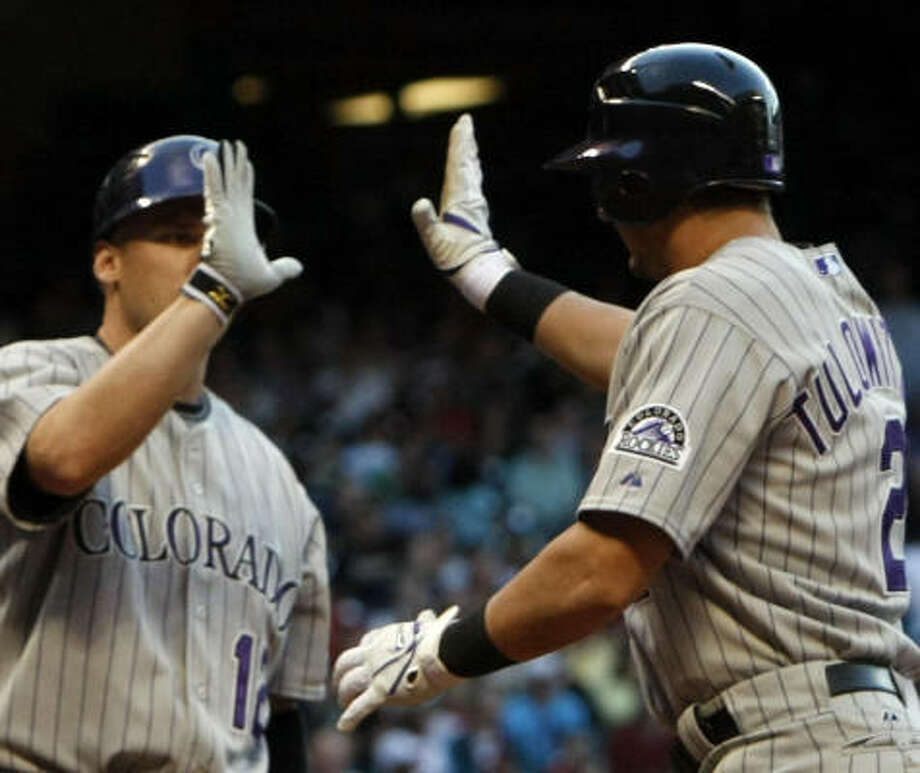 Clint Barmes (left) and Troy Tulowitzki celebrate a first-inning run for Colorado. Photo: Johnny Hanson, Chronicle