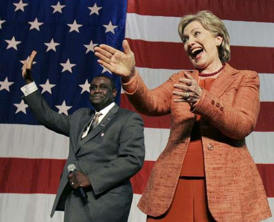 Sen. Hillary Rodham Clinton greets supporters in Sioux Falls, S.D., on Thursday with Rapid City Councilman Malcom Chapman. Photo: ELISE AMENDOLA, ASSOCIATED PRESS