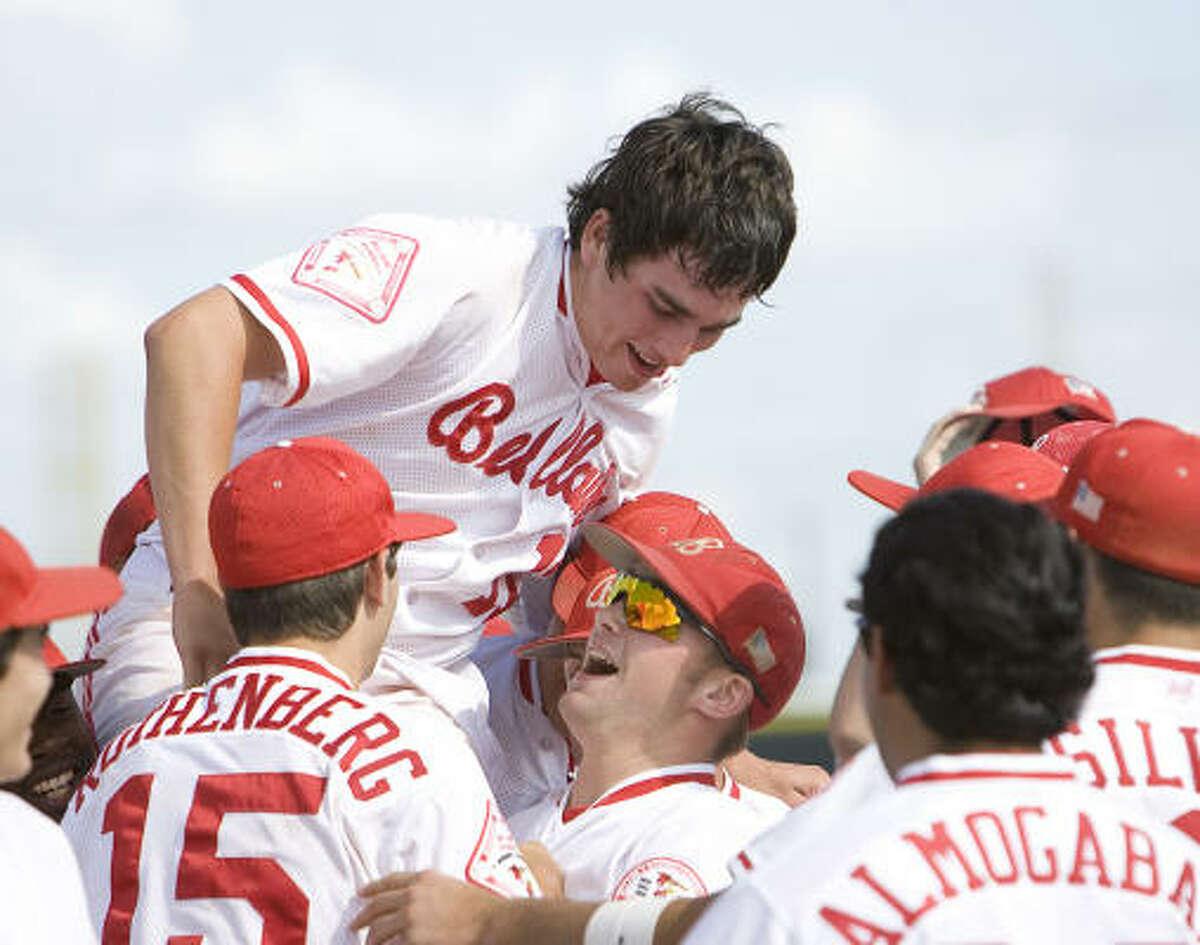 Jeffrey Rohrbach, top, and teammates celebrates Bellaire's series-clinching win against Westside on Saturday.