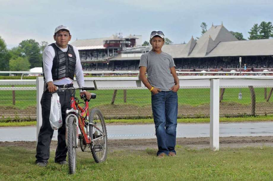 Marco Antonio Acosta Rodriguez, left, and Alfonzo Rodriguez, right, at the Saratoga Race Course on Wednesday Aug. 3, 2011 in Saratoga Springs, NY.  They took part in the Saratoga Economic Opportunity Council's Latino Advocacy Program photography program for backstretch workers, so they can photograph the life few people see. Next week, EOC is holding a reception to show off the work and raise money for the Latino Advocacy Program. (Philip Kamrass / Times Union) Photo: Philip Kamrass / 00014113A