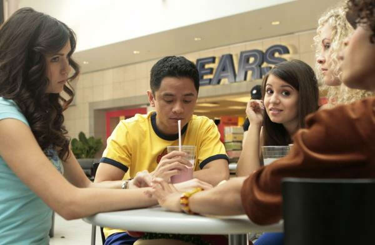 Actors Nina Dobrev, Rodney To, Bianca Collins, Nikola Clark and Bresha Webb appear in a scene from The American Mall, a film set to be released in the fall which features a massive cross-promotion between MTV and Sears. The retailer is using the movie to try to appeal to the young, hip, urban segment.