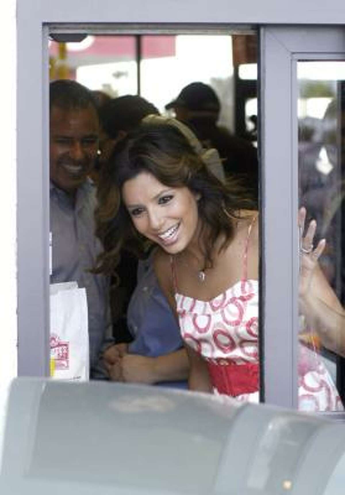 Eva Longoria Parker served up Frosties and french fries at a Wendy's in Corpus Christi on Tuesday.