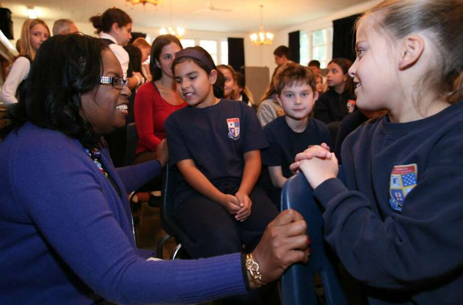 Sharon Robinson,daughter of baseball legend Jackie Robinson, speaks with Greenwich Catholic School student Sydney Borsellino before the start of her address to the student body Friday morning. Photo: David Ames / Greenwich Time