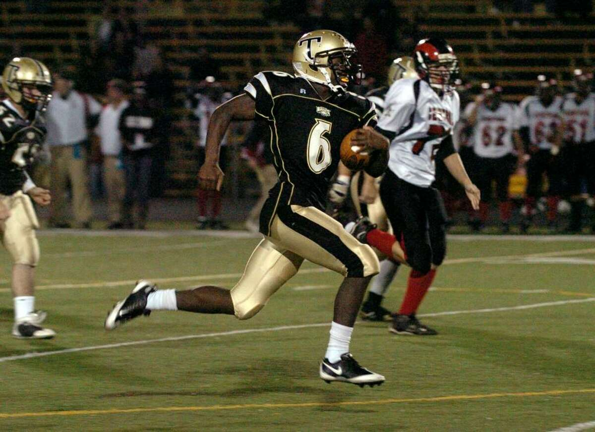 Trumbull's #6 Frank Gaines carries the ball 75 yards for a touchdown after catching the kickoff in the start of the third quarter, during game action against Central in Trumbull, Conn. on Friday Oct. 09, 2009.
