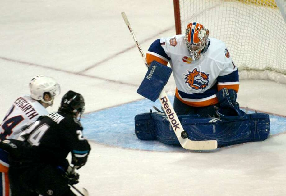 Sound Tigers goalie #1 Mikko Koskinen deflects a Worcester shot, during hockey action in Bridgeport, Conn. on Friday Oct. 09, 2009. Photo: Christian Abraham / Connecticut Post