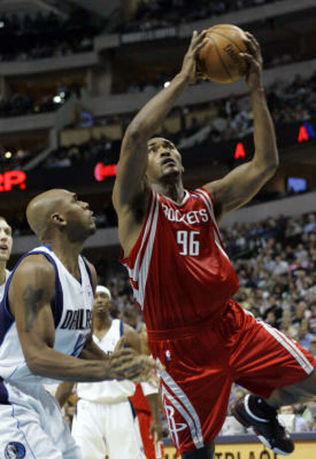 Rockets forward Ron Artest goes to the basket against Dallas Mavericks guard Jerry Stackhouse during the first half on Thursday in Dallas. Photo: Donna McWilliam, AP