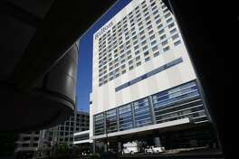 The Hilton Americas-Houston, framed by the George R. Brown Convention Center, may be for sale by the city.