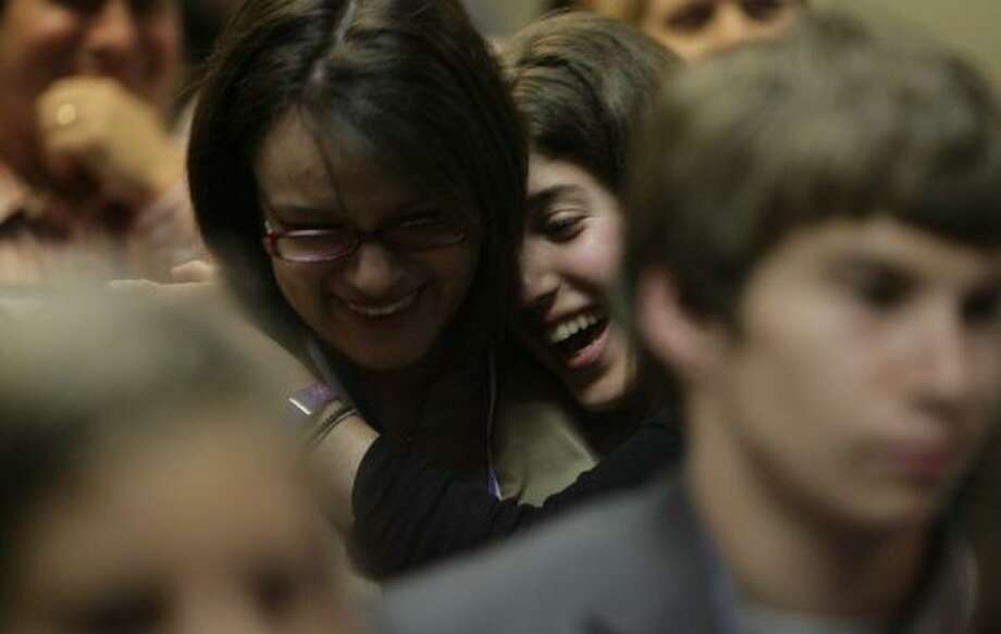 Paloma Lenz of Milby High School, left, celebrates with classmate Rebecca Goldstein after Lenz was named Student Journalist of the Year during graduation Tuesday for the Houston Chronicle Classroom. Publisher Jack Sweeney said he hopes participants might one day join the staff. Photo: JULIO CORTEZ, CHRONICLE