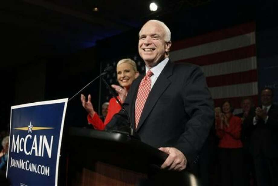 Sen. John McCain and his wife, Cindy, bask in Super Tuesday victory at a party in Phoenix, Ariz., on Tuesday. Photo: Charles Dharapak, Associated Press