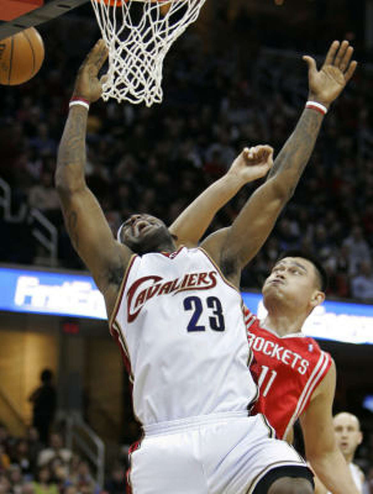 Cleveland Cavaliers forward LeBron James has the ball knocked away by Houston Rockets' Yao Ming during the first quarter.