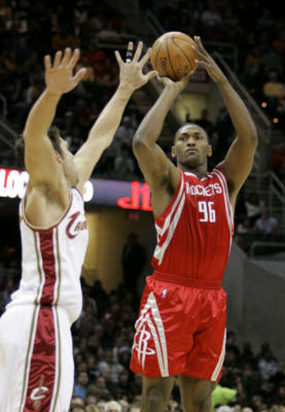 Houston Rockets' Ron Artest shoots a three-point shot over Cleveland Cavaliers' Wally Szczerbiak.