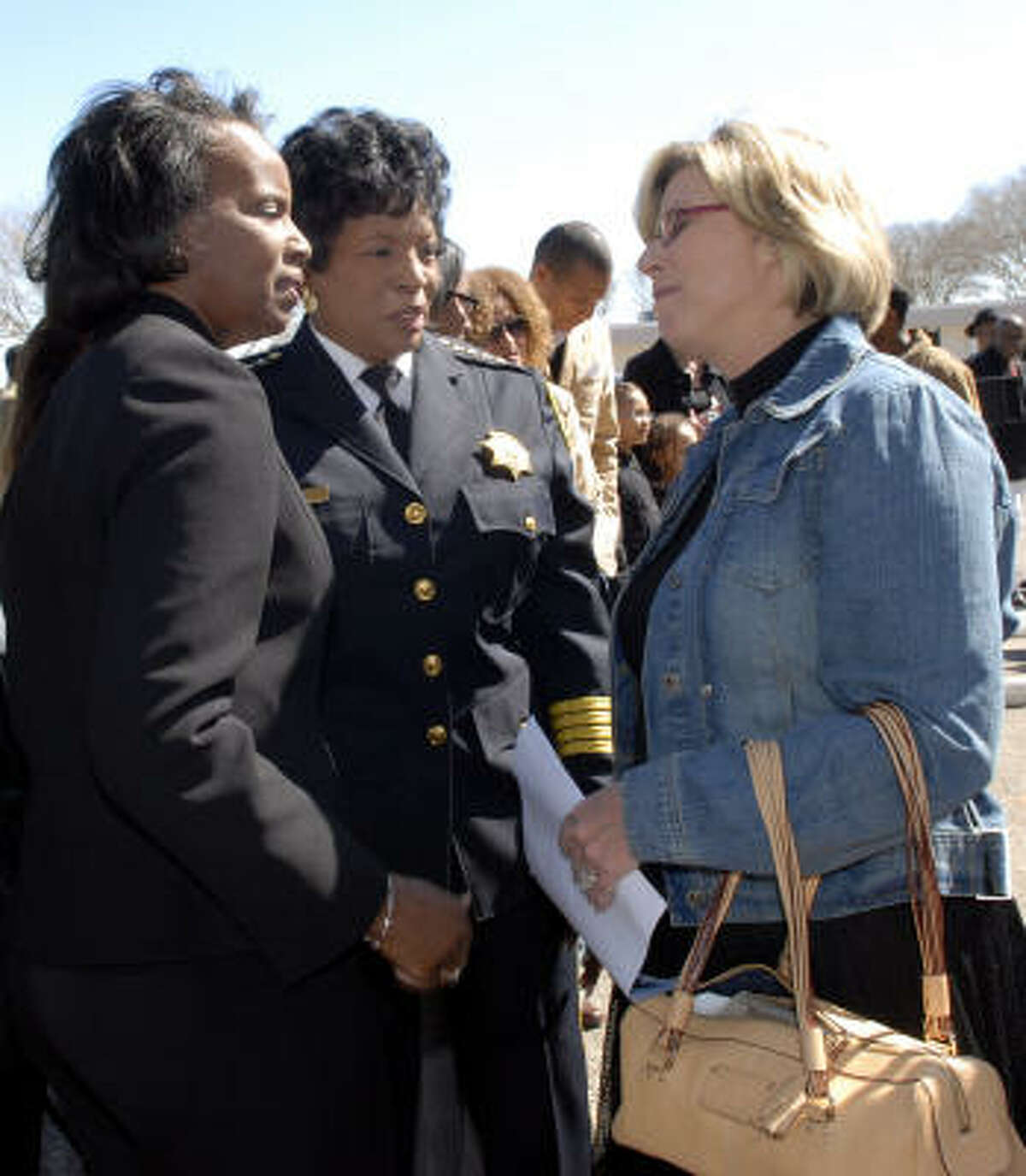 Precinct 7 Constable May Walker, center, and Cathy Hill, right, greet Annette Joubert, left, after the Flag of Honor ceremony at the Precinct 7 Headquarters on Feb. 13.