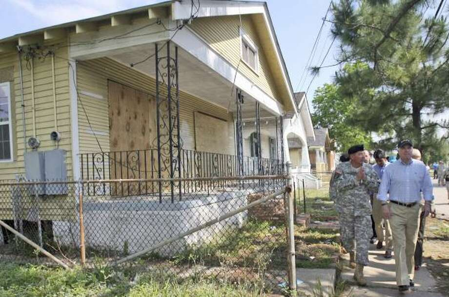 Republican presidential candidate Sen. John McCain, right, tours New Orleans' Lower 9th Ward on Thursday. Photo: MARY ALTAFFER, ASSOCIATED PRESS