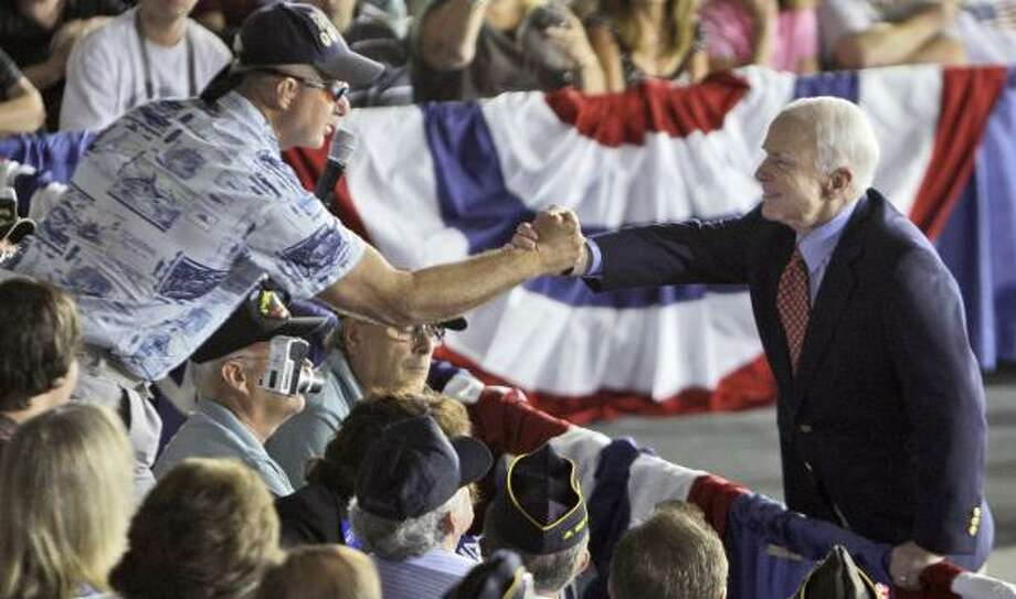 John McCain shakes hands with a supporter in Pemberton, N.J., where he went solo to his first town hall meeting. Photo: LM OTERO, ASSOCIATED PRESS