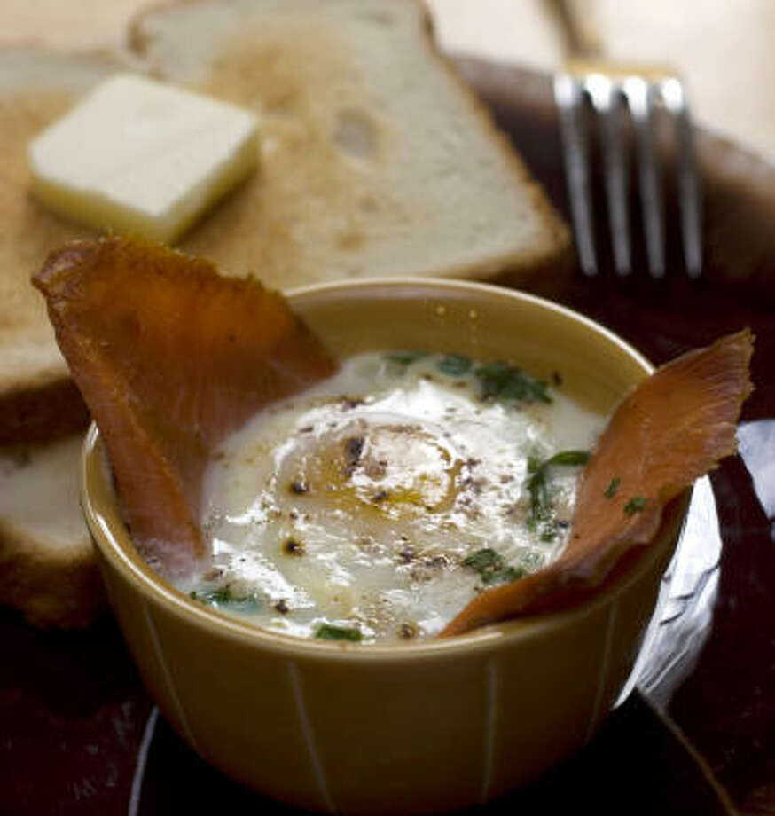WORTH WAKING UP FOR: Baked Eggs With Smoked Salmon and Chives is easy to make, even before you've drunk your coffee. Photo: Larry Crowe, Associated Press