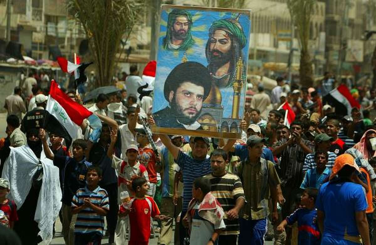 Iraqi Shiite supporters of Shiite cleric Moqtada al-Sadr gathered after a Friday prayer service inBaghdad to protest a pact being negotiated by the Iraqi and U.S. governments regarding U.S. troop presence.