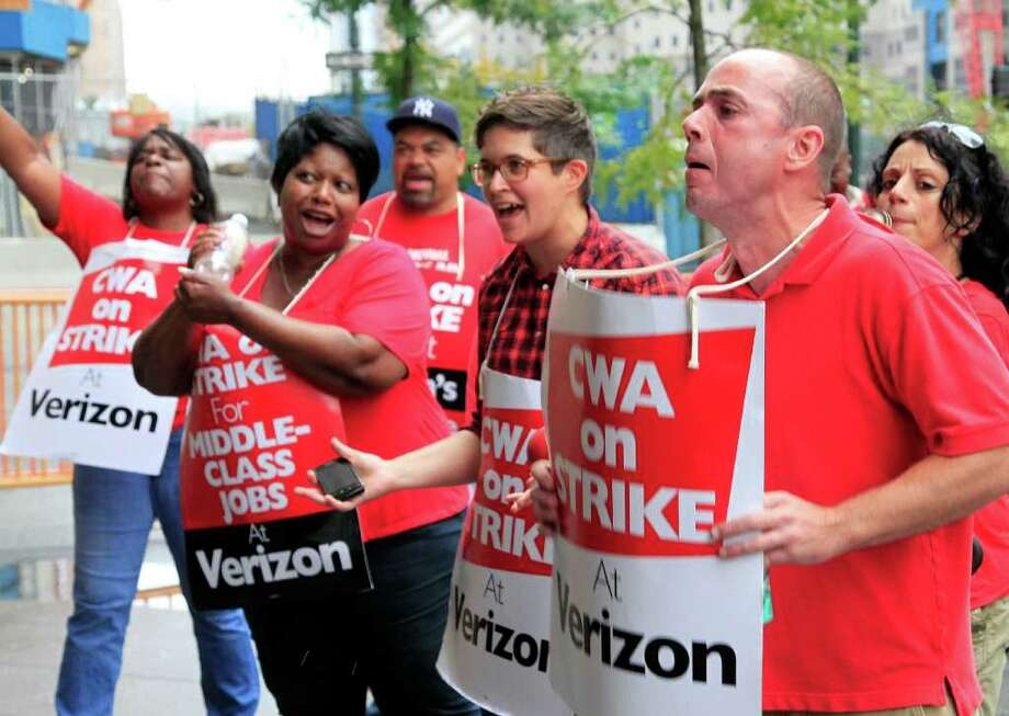 Verizon workers picket in front of the company's headquarters, Sunday, Aug. 7, 2011, in New York. Forty-five thousand Verizon Communications Inc. workers from Massachusetts to Washington, D.C., went on strike Sunday after negotiations fizzled over a new labor contract for more than a fifth of the company's work force. (AP Photo/Mark Lennihan) Photo: Mark Lennihan