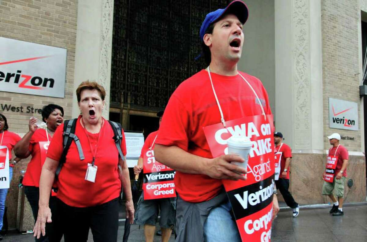Verizon workers picket in front of the company's headquarters, Sunday, Aug. 7, 2011, in New York. Forty-five thousand Verizon Communications Inc. workers from Massachusetts to Washington, D.C., went on strike Sunday after negotiations fizzled over a new labor contract for more than a fifth of the company's work force. (AP Photo/Mark Lennihan)