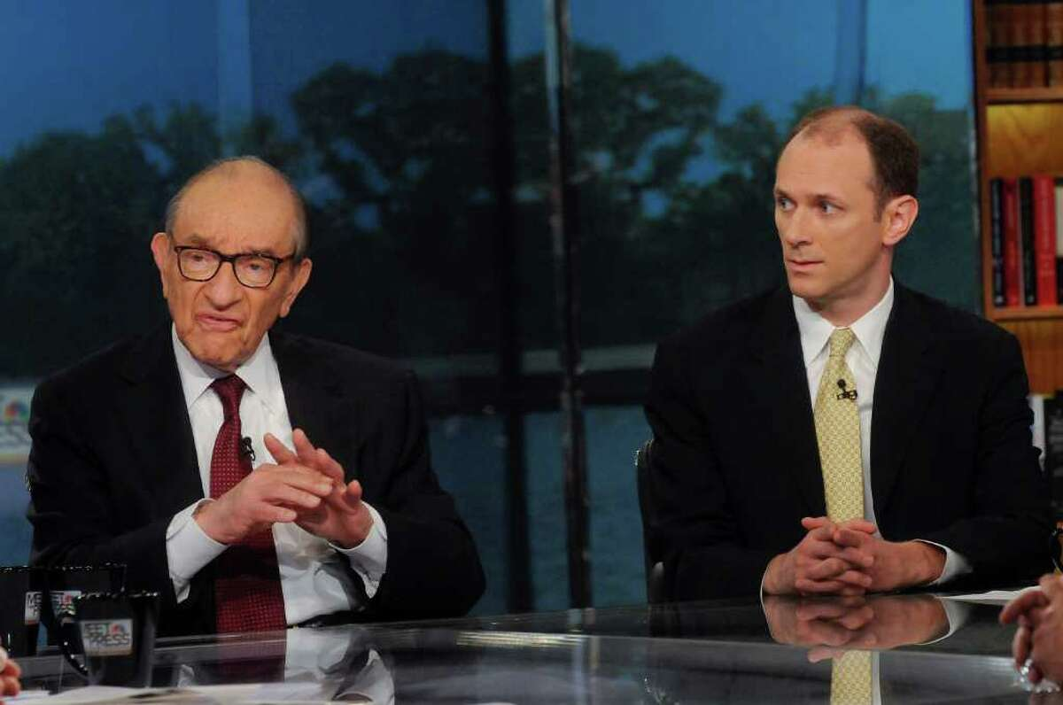 In this photo provided by NBC News, Dr. Alan Greenspan, former chairman of the Federal Reserve, and Austan Goolsbee, former chair of the White House Council of Economic Advisers, right, are interviewed on NBC's