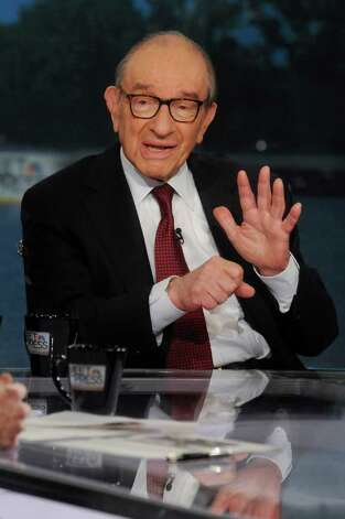 "In this photo provided by NBC News, Dr. Alan Greenspan, former chairman of the Federal Reserve, speaks on NBC's ""Meet the Press""  in Washington, Sunday, Aug. 7, 2011. Greenspan said he expects the stock market slide to continue Monday in the wake of a decision by credit rating agency Standard & Poor's to downgrade the U.S. credit rating. He said it will take time for the markets to bottom out, but he said he sees no risk in investing in the United States and says that S&P's downgrade won't change that.  (AP Photo/NBC News, William B. Plowman) Photo: William B. Plowman"
