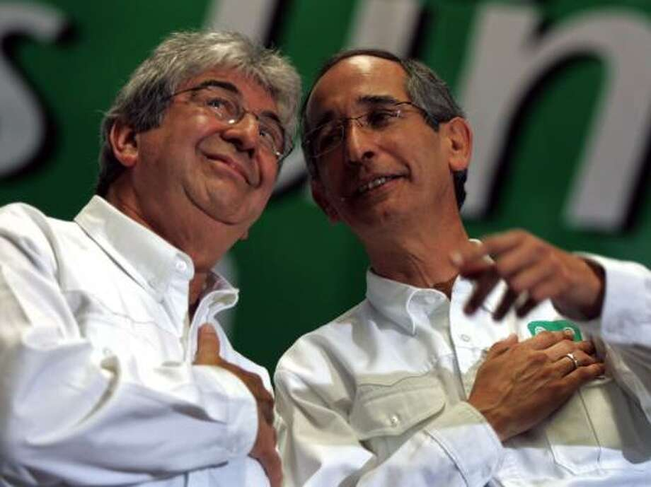 Rafael Espada, left, and Alvaro Colom attend a May 6 political rally in Guatemala City in this file photo. Colom will be sworn in as the nation's president on Monday, and Espada the vice president. The election in the Central American nation was held last fall. Photo: ORLANDO SIERRA, AFP/GETTY IMAGES FILE