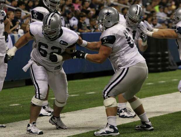 Cowboys guard David Arkin (left) goes through drills with center Phil Costa (right) before the Blue-White scrimmage on Sunday, Aug. 7, 2011. The game was part of Dallas' training camp at the Alamodome. Photo: John Davenport/jdavenport@express-news.net
