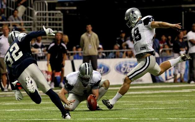 Cowboys punter Mat McBriar holds the ball while kicker David Buehler (right) makes a field goal attempt during the Blue-White scrimmage on Sunday, Aug. 7, 2011. On the left is cornerback Orlando Scandrick. The scrimmage was part of Dallas' training camp at the Alamodome. Photo: John Davenport/jdavenport@express-news.net / SAN ANTONIO EXPRESS-NEWS