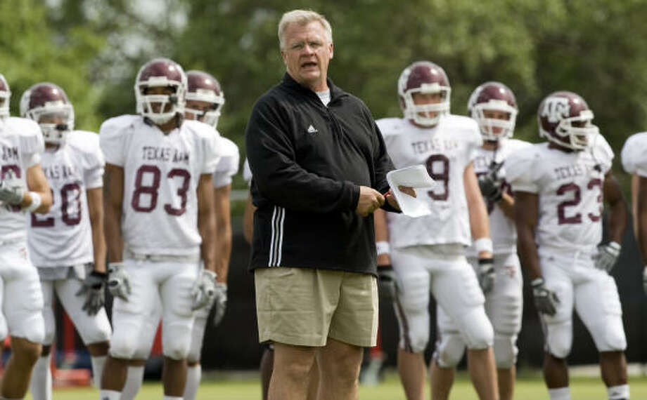 Texas A&M football coach Mike Sherman (center) has his hands full trying to turn around the Aggies program. Photo: Brett Coomer, Chronicle