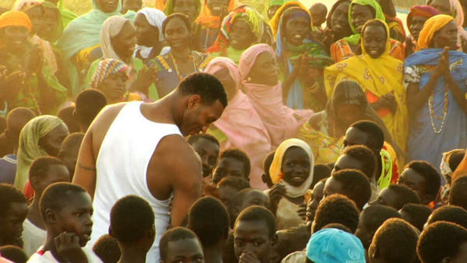 Tracy McGrady is surrounded by Darfur children during a visit to a refugee camp in southeastern Chad last year. Photo: Special To The Chronicle
