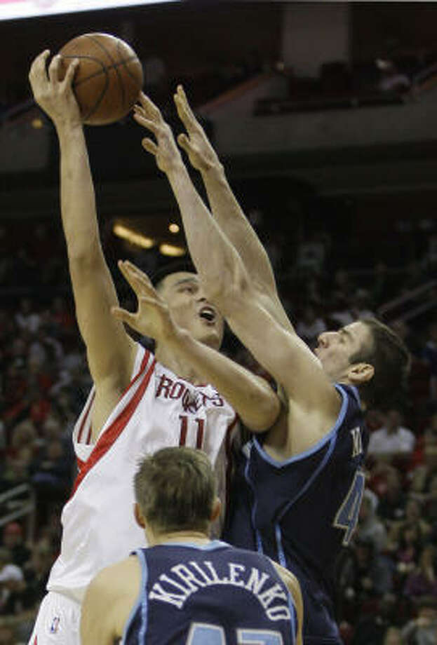Rockets 120, Jazz 115 Rockets center Yao Ming goes up for a shot as Utah Jazz center Kosta Koufos (41) defends during the second quarter. Photo: Brett Coomer, Chronicle