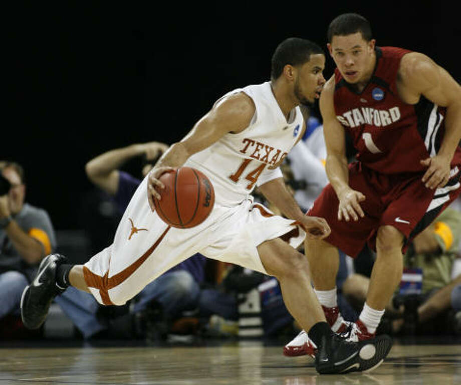 D. J. Augustin, who scored 21 points for the Longhorns, drives around Stanford's Mitch Johnson during the first half. Photo: Kevin Fujii, Chronicle